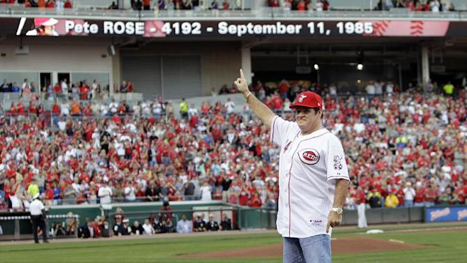 FILE - In this Sept. 11, 2010, file photo, former Cincinnati Reds great Pete Rose stands on first base as he acknowledges the crowd during ceremonies celebrating the 25th anniversary of Rose breaking Ty Cobb's hit record prior to a baseball game between the Reds and Pittsburgh Pirates in Cincinnati. Rose may have a role to play in next year's All-Star game in Cincinnati despite his lifetime ban from baseball. The career hits leader generally is not allowed in any areas of major league ballparks not open to fans. (AP Photo/Al Behrman, File)