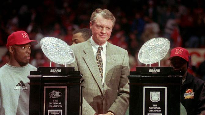 FILE - In this Jan. 3, 1996 file photo, Nebraska head football coach Tom Osborne stands between Nebraska's two National Championship trophies during the homecoming rally at the Devaney Sports Center in Lincoln, Neb. Osborne, the retired Nebraska coach isn't getting drawn into arguments over how his 1990s teams that won three national championships in four years would fare against the Alabama teams that just accomplished the same feat. Osborne said Wednesday he admires what the Crimson Tide has done under Nick Saban. The Cornhuskers' 60-3 record from 1993-97 is the greatest five-year stretch in history. Alabama is 61-7 since 2008.   (AP Photo/Dave Weaver, File)