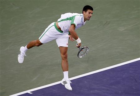 Novak Djokovic of Serbia serves against Fabio Fognini of Italy during their match at the BNP Paribas Open ATP tennis tournament in Indian Wells, California