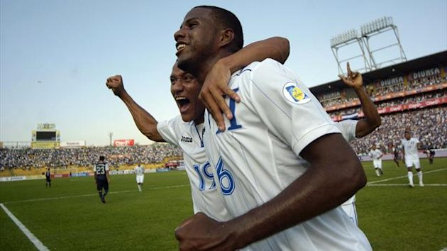 Honduras' Juan Garcia (R) celebrates with teammate Luis Garrido after scoring against the U.S. during their 2014 World Cup qualifying soccer match at Olimpico stadium in San Pedro Sula February 6, 2013 (Reuters)
