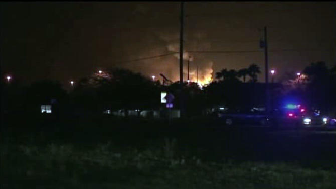 This frame grab from an Associated Press video shows flames from a gas plant explosion in Tavares City, Fla., Monday July 29, 2013. A series of major explosions at has injured several workers and left others missing. The Orlando Sentinel reported Monday night that Tavares City Administrator John Drury said 10 of 24 people working at Blue Rhino, a propane gas plant, have not been accounted for after the blasts. Lake County Sheriff Gary Borders says the blasts occurred inside the plant and blew the roof off. The newspaper reports that the blasts began about 11 p.m. and continued for about an hour. (AP Photo)