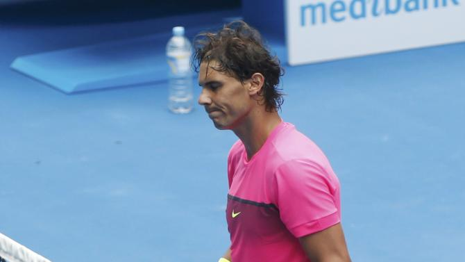 Nadal of Spain leans on the net as he waits to shake hands with Berdych of the Czech Republic after their men's singles quarter-final match at the Australian Open 2015 tennis tournament in Melbourne