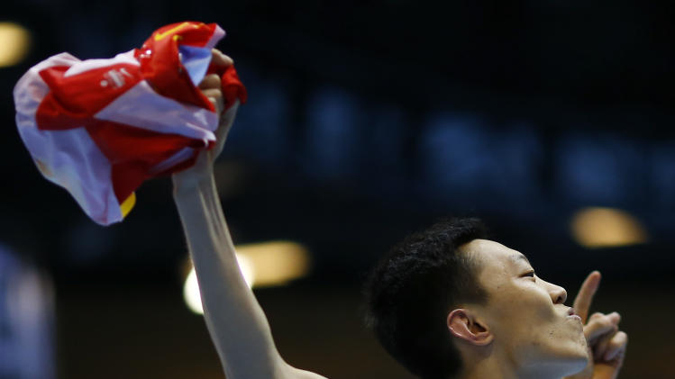 China's Zhang celebrates during men's high jump qualification at world indoor athletics championships in Sopot