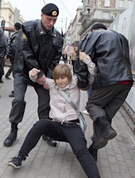 Anastasiya Rybachenko is detained by police officers during an opposition rally in Moscow. Later when police searched her apartment while she was in Europe, Rybachenko decided not to come back