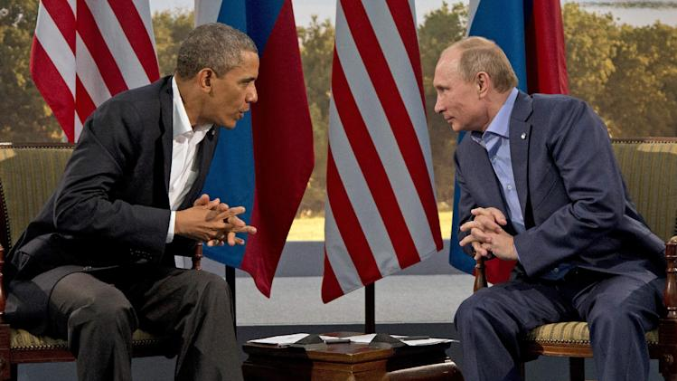 FILE - In this June 17, 2013, file photo, President Barack Obama meets with Russian President Vladimir Putin in Enniskillen, Northern Ireland. The White House is considering canceling a fall summit between President Barack Obama and Russian President Vladimir Putin in Moscow, a move that would further aggravate the already tense relationship between the two leaders. The White House is dangling that option over the Russians as Moscow considers a temporary asylum petition from Edward Snowden, the American accused of leaking information about classified U.S. intelligence programs.(AP Photo/Evan Vucci, File)