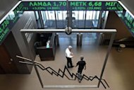 <p>Employees walk at Athens stock exchange. World stock markets initially rallied in reaction to Sunday's elections and the euro rose sharply against the dollar but the gains quickly petered out amid broader concerns about other indebted euro economies like Italy and Spain.</p>