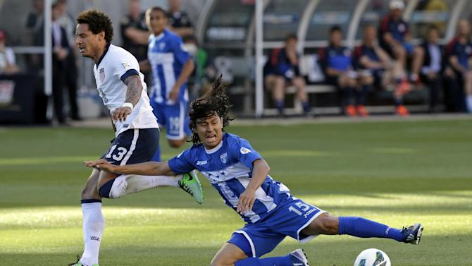 Honduras' Roger Espinoza (15) falls as United States' Jermaine Jones (13) defends in the first half during a World Cup qualifying soccer match at Rio Tinto Stadium on Tuesday, June 18, 2013, in Sandy, Utah. (AP Photo/Rick Bowmer)