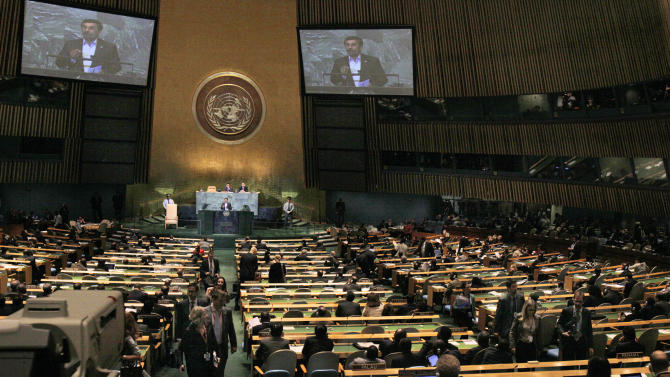 Delegates leave the UN General Assembly hall as Iran's President Mahmoud Ahmadinejad addresses the 66th session of the United Nations General Assembly, Thursday, Sept. 22, 2011. (AP Photo/Richard Drew)