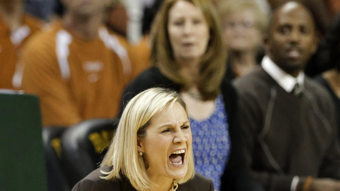 Texas head coach Karen Aston yells out loud as her team is called for a foul in the first half of an NCAA college basketball game against Baylor Saturday, Feb. 23, 2013, in Waco, Texas. (AP Photo/Tony Gutierrez)