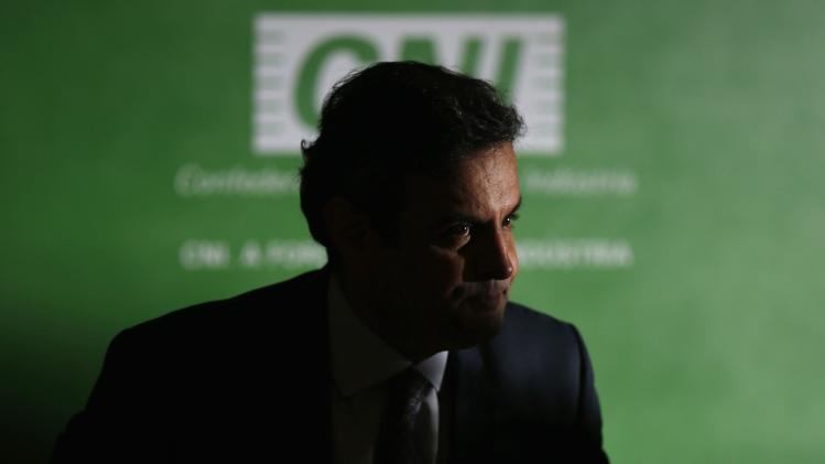 President of the opposition PSDB and presidential candidate Neves speaks during a news conference after a meeting at the CNI headquarters in Brasilia