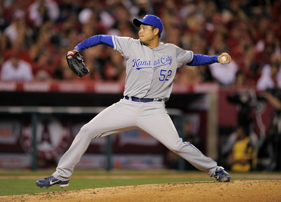 Kansas City Royals starting pitcher Bruce Chen throws to the plate during the fourth inning of their baseball game against the Los Angeles Angels, Friday, April 6, 2012, in Anaheim, Calif. (AP Photo/Mark J. Terrill)