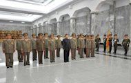 Image released by the KCNA shows North Korean leader Kim Jong-Un visiting the Kumsusan Palace of the Sun. North Korea&#39;s parliament held a rare session Tuesday, which had been expected to confirm an apparent push by the new leader to introduce limited economic reforms