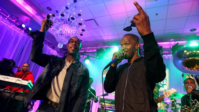 IMAGE DISTRIBUTED FOR PEPSI - Tank and Jamie Foxx perform with The Roots at the Pepsi 5th Quarter in the French Quarter Post Super Bowl Party, on Sunday, Feb. 3, 2013, in New Orleans. (Photo by Barry Brecheisen/Invision for Pepsi/AP Images)