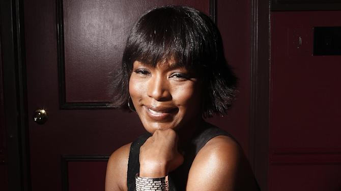 """FILE - This Jan. 12, 2012 file photo shows actress Angela Bassett at Sardi's restaurant in New York. Bassett co-stars in the action flick, """"Olympus Has Fallen.""""   (AP Photo/Carlo Allegri, file)"""