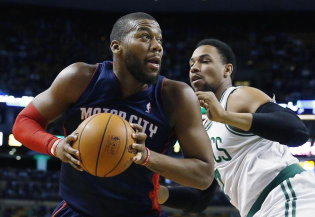 Detroit Pistons' Greg Monroe, left, looks to shoot past Boston Celtics' Jared Sullinger, right, in the first quarter of an NBA basketball game in Boston, Sunday, March 9, 2014. (AP Photo/Micha