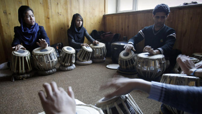 In this Monday,  Jan. 7, 2013, photo, Afghan students practice playing the drums in a class at the Afghanistan National Institute of Music in Kabul, Afghanistan. Dozens of Afghan teenagers including former street kids or orphans aged 10 to 22, will be playing in the Afghan Youth Orchestra which begins a 12-day U.S. tour on Feb. 3 and includes concerts at Washington's Kennedy Center - President Barrack Obama has been invited - New York's Carnegie Hall and the New England Conservatory in Boston.  (AP Photo/Musadeq Sadeq)