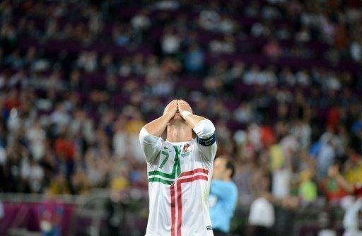 Portuguese forward Cristiano Ronaldo reacts after missing a goal opportunity