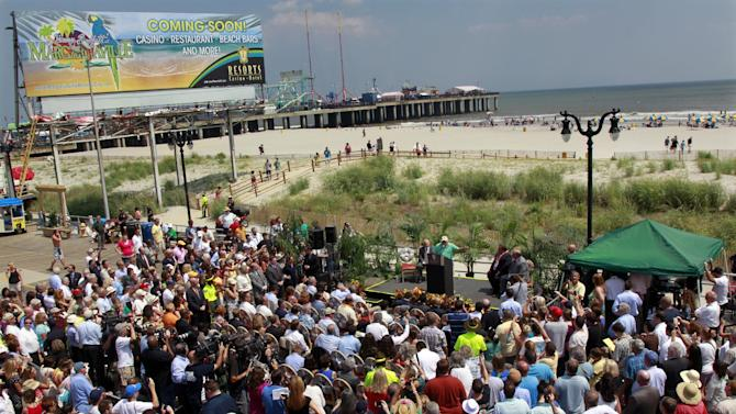New Jersey Gov. Chris Christie, center second right, and Sen. Stephen M. Sweeney, center right, D-West Deptford, look on in Atlantic City, N.J., Monday, July, 24, 2012, as singer Jimmy Buffett, center at podium, announces that he is teaming up with Resorts Casino Hotel to bring one of his Margarativille casino-entertainment complexes to Atlantic City. The project will be built as an addition to the Resorts Casino Hotel. (AP Photo/Mel Evans)