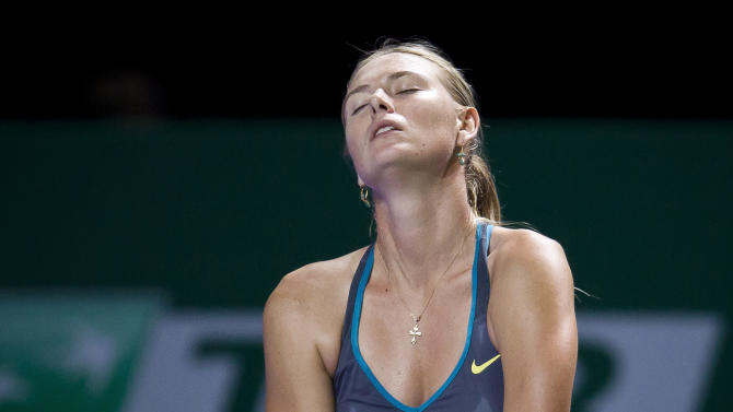 Maria Sharapova of Russia reacts during a tennnis match against Samantha Stosur of Australia at the WTA championship in Istanbul, Turkey, Tuesday, Oct. 25, 2011. Sharapova lost to Stosur 6-1, 7-5. (AP Photo/Vadim Ghirda)