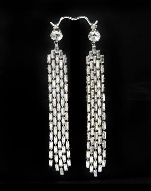 """This image provided courtesy of Julien's Auctions shows a pair of rhinestone earrings worn by Marilyn Monroe to a 1955 Hollywood film premiere, """"The Rose Tattoo."""" The earrings have sold at auction for $185,000. The sale was part of a two-day auction of Hollywood memorabilia April 11, 2014, and April 12, at Julien's Beverly Hills gallery in Los Angeles. (AP Photo/Courtesy of Julien's Auctions)"""