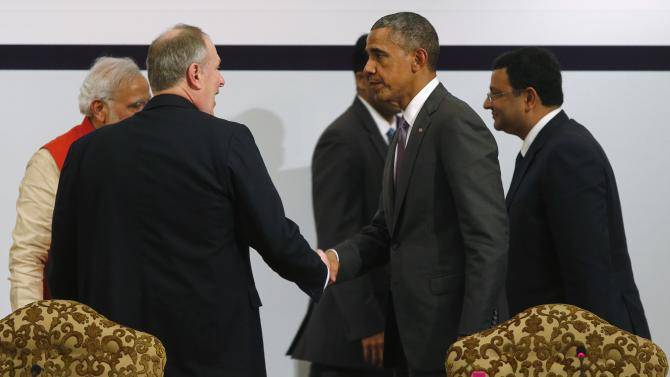 U.S. President Obama shakes hands with Honeywell CEO Cote as they depart with India's Prime Minister Modi and TATA Group Chairman Mistry at the conclusion of a CEO Forum at the India U.S. Business Summit in New Delhi