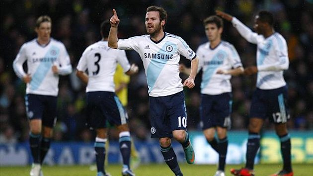 Chelsea's Juan Mata, centre, celebrates scoring the opening goal against Norwich