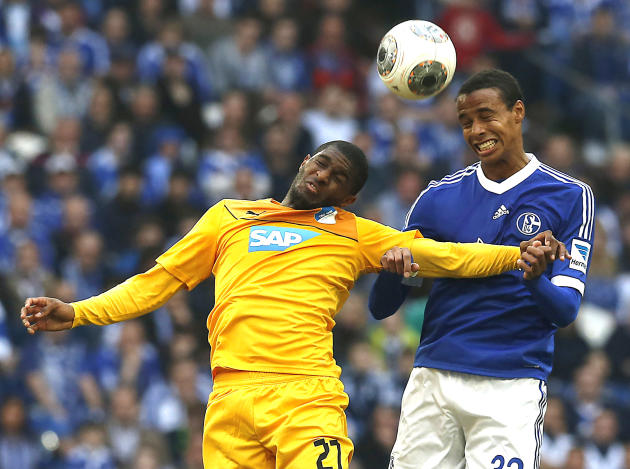 Hoffenheim's Anthony Modeste of France, left, and Schalke's Joel Matip of Cameroon challenge for the ball during the German first division Bundesliga soccer match between Schalke 04 and 1899 H