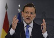 Spanish Prime Minister Mariano Rajoy takes part in a press conference at Moncloa palace in Madrid. Spain will study the new measures being planned by the European Central Bank to ease the eurozone debt crisis before deciding whether or not to use them, Rajoy said