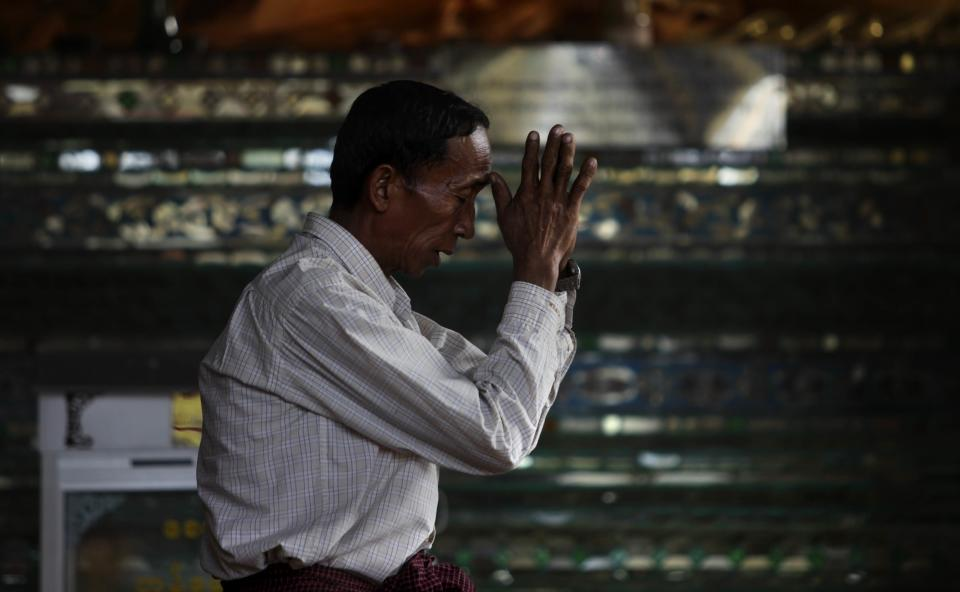 A Myanmar Buddhist prays at Shwedagon Pagoda on the eve of its 2600th anniversary celebrations in Yangon, Myanmar, Tuesday, Feb. 21, 2012. (AP Photo/Altaf Qadri)