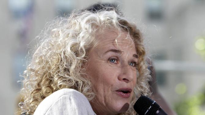 """FILE - This June 18, 2010 file photo shows Carole King performing on the NBC """"Today"""" television program in New York. King is the first woman to win the Library of Congress' Gershwin Prize for Popular Song for her five decades of songwriting. (AP Photo/Richard Drew, File)"""