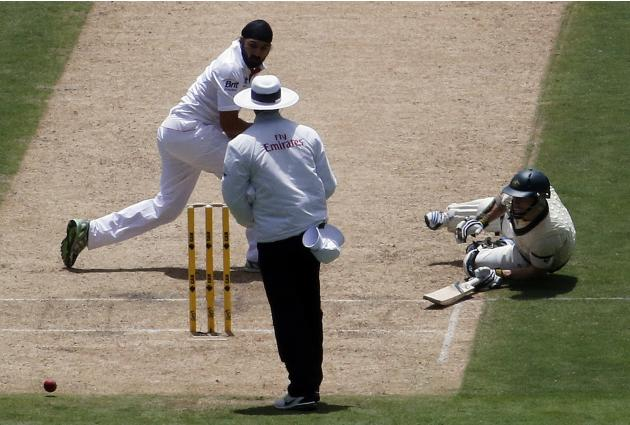 Australia's Rogers dives as England's Panesar fails to stop the ball during the first day's play in the second Ashes test in Adelaide