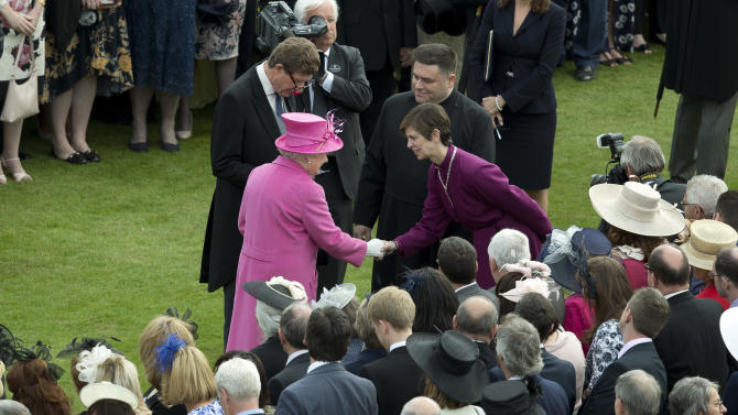 Britain's Queen Elizabeth II, centre left greets Libby Lane, the Bishop of Stockport, who is the first female bishop in the English Anglican church, during a garden party at Buckingham Palace in London, Thursday, May 28, 2015. (AP Photo/Alastair Grant, Pool)
