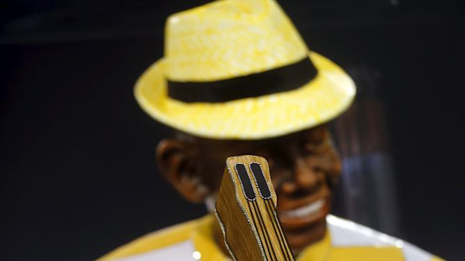 Revellers parade for the Unidos do Peruche samba school during the carnival in Sao Paulo, Brazil