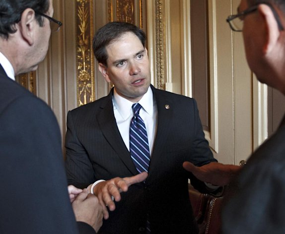 FILE - In this May 24, 2012, file photo, Sen. Marco Rubio, R-Fla., speaks just off the Senate floor on Capitol Hill in Washington, during a series of votes. Republican presidential candidate Mitt Romney is staying mum on whether Rubio, a rising star in Republican politics, has been eliminated from his short list of potential running mates. The presumptive GOP presidential nominee told Fox News on Tuesday, June 19, 2012, that &quot;a number of people are being vetted,&quot; but that only two people, himself and a senior adviser, know who&#39;s on the list. (AP Photo/J. Scott Applewhite, File)