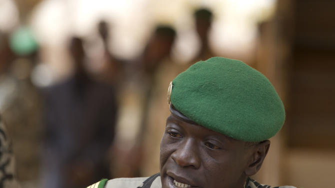 Coup leader Capt. Amadou Haya Sanogo addresses the press at junta headquarters in Kati, outside Bamako, Mali Friday, March 30, 2012. The junior officer who grabbed power in a coup says he plans to hold free elections and to rapidly return Mali to its established order, but refused to give a timetable even as neighboring countries prepare to enact severe financial sanctions.(AP Photo/Rebecca Blackwell)