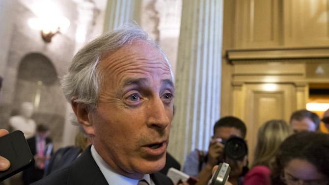 Sen. Bob Corker, R-Tenn., speaks with reporters after the immigration bill got more than 60 needed votes to advance in the Senate, at the Capitol in Washington, Monday, June 24, 2013. A measure he crafted with Sen. John Hoeven, R-N.D., includes changes to the original border security provisions in the bill that would double the size of the U.S. Border Patrol and completes 700 miles of fencing on the border with Mexico. (AP Photo/J. Scott Applewhite)