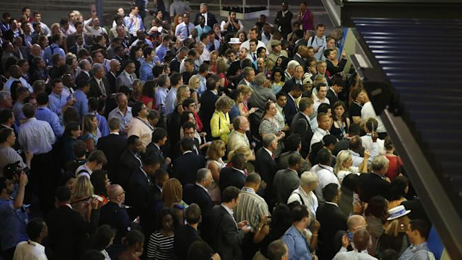 Hundreds of delegates wait outside of Time Warner Cable Arena as the entrance is closed during the Democratic National Convention in Charlotte, N.C., on Wednesday, Sept. 5, 2012. (AP Photo/Jae C. Hong)