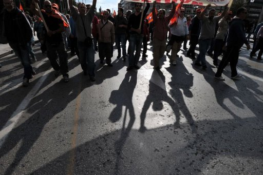 <p>On strike municipality workers demonstrate in central Athens to protest new austerity measures and excpected layoffs in the public sector.</p>