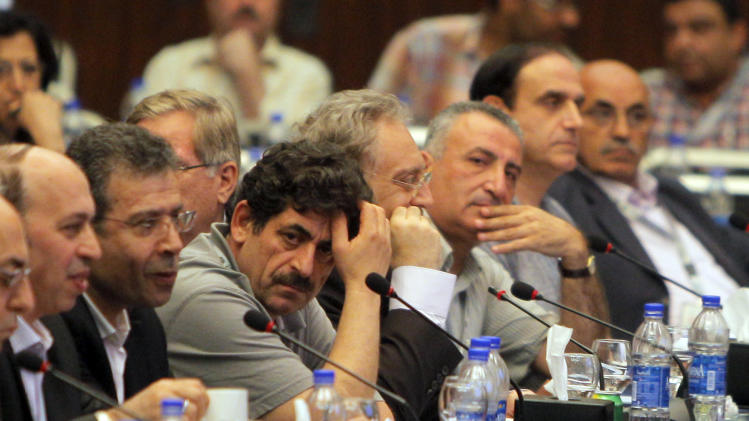 Exiled Syrian opposition figures meet in New Cairo, Egypt, Tuesday, July 3, 2012. The Arab League chief urged exiled Syrian opposition figures to unite at a meeting as a new Western effort to force President Bashar Assad from power faltered. (AP Photo/Amr Nabil)