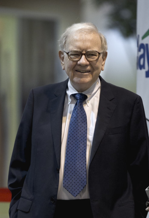 In this May 5, 2012, photo, Warren Buffett, chairman and CEO of Berkshire Hathaway, smiles on the exhibit floor where Berkshire products are showcased, prior to the annual shareholders meeting in Omah