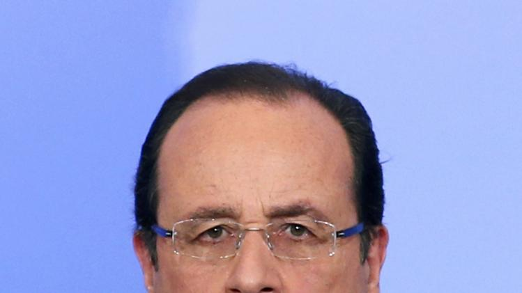 France's President Francois Hollande attends a news conference at the Elysee Palace at the end of the Elysee Summit for Peace and Security in Africa, in Paris,