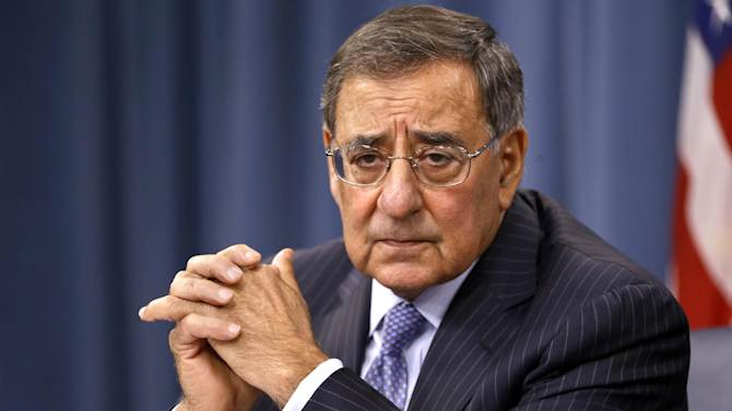 """FILE - In this Sept. 27, 2012, file photo, Defense Secretary Leon Panetta listens during a news conference at the Pentagon in Washington. House Republicans' """"fiscal cliff"""" counteroffer to President Barack Obama hints at billions in dollars of defense cuts on top of the $500 billion that the White House and Congress backed last year. (AP Photo/Jacquelyn Martin, File)"""