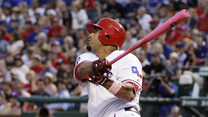 Texas Rangers' Nelson Cruz follows through on a grand slam off a pitch from Los Angeles Angels' Jered Weaver in the third inning of a baseball game, Sunday, May 13, 2012, in Arlington, Texas. The shot scored David Murphy, Adrian Beltre and Michael Young. (AP Photo/Tony Gutierrez)