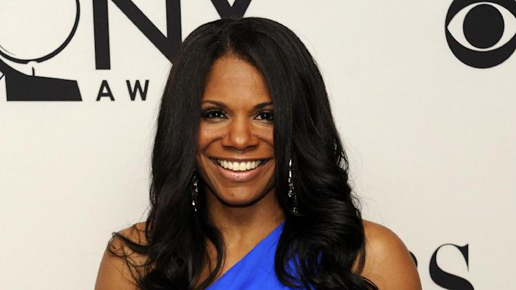 "FILE - This June 10, 2012 file photo shows Audra McDonald backstage with her award for best actress in a musical for her role in ""The Gershwins' Porgy and Bess"" at the 66th annual Tony Awards in New York. Producers said Tuesday, Feb. 25, 2014, that the five-time Tony Award-winner will star in Lanie Robertson's ""Lady Day at Emerson's Bar & Grill,"" a musical build around one of Holiday's last performances. Previews begin March 25 at the Circle in the Square Theatre and opening night is set for April 13.(Photo by Evan Agostini /Invision/AP, File)"