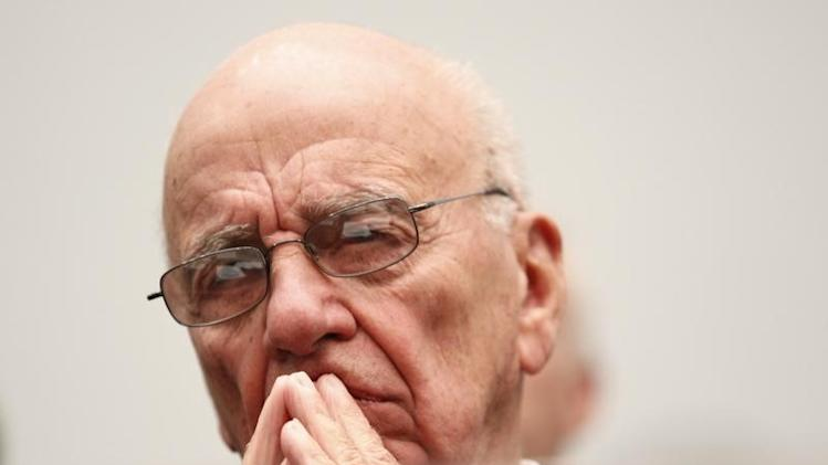 TIMEWARNER changes rules as Murdoch circles...