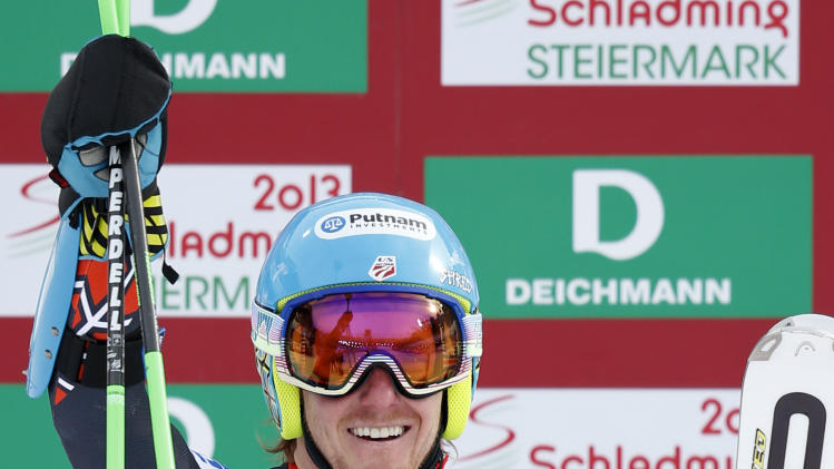 United States's Ted Ligety celebrates winning the gold medal after the second run of the men's giant slalom at the Alpine skiing world championships in Schladming, Austria, Friday, Feb.15,2013. (AP Photo/Matthias Schrader)