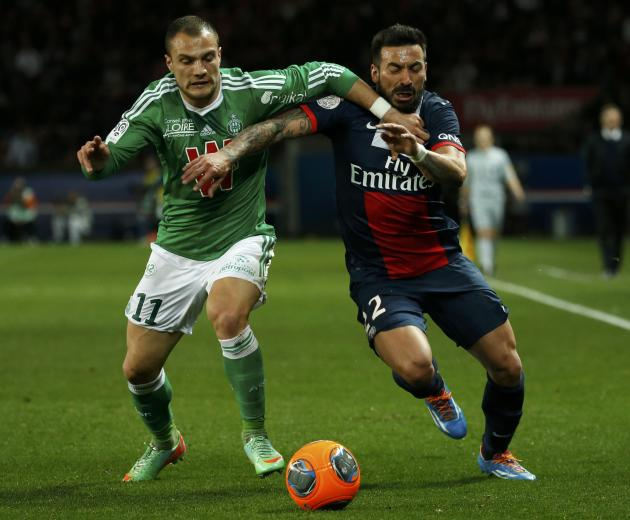 St Etienne's Molo challenges Paris St Germain's Lavezzi during their French Ligue 1 soccer match at the Parc des Princes Stadium in Paris