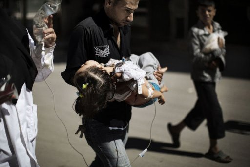 "A Syrian man carries his wounded daughter outside a hospital in the northern city of Aleppo on September 18, 2012. Amnesty accused Syrian forces Wednesday of waging ""relentless, indiscriminate"" attacks against its people as a Syrian army defector warned the regime would use chemical weapons as a last resort."
