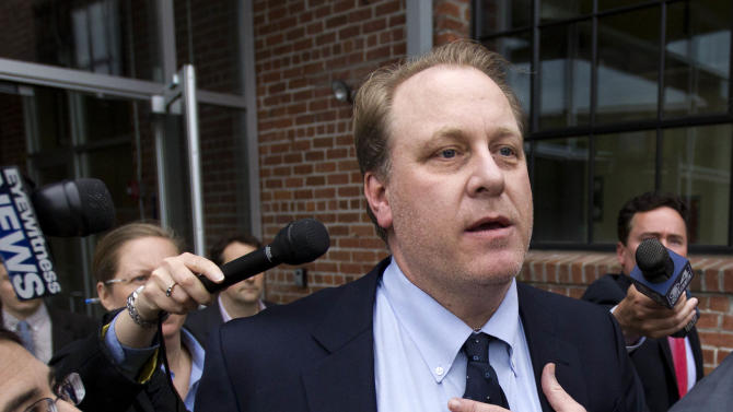 FILE - In this Wednesday, May 16, 2012, file photo, former Boston Red Sox pitcher Curt Schilling, center, is followed by members of the media as he departs the Rhode Island Economic Development Corporation headquarters, in Providence, R.I. Schilling's troubled video gaming company filed for bankruptcy in Delaware, on Thursday, June 7, 2012.. (AP Photo/Steven Senne, File)