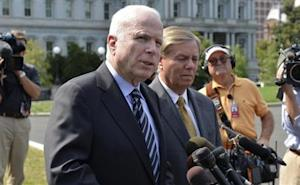 U.S. Senator McCain (R-AZ) makes remarks to the media as U.S. Senator Lindsey Graham (R-SC) listens, after meeting with U.S. President Obama at the White House in Washington
